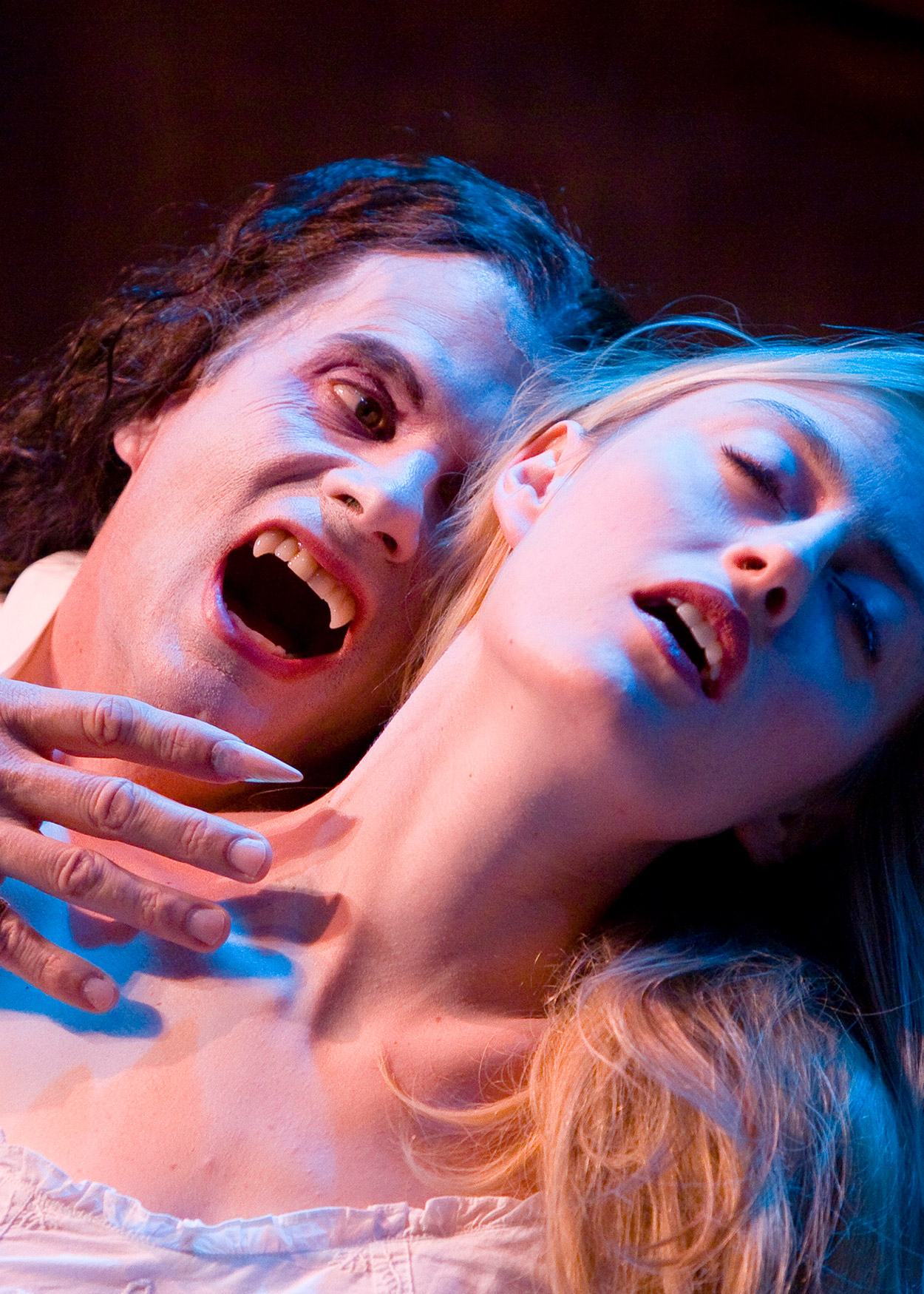 Dracula biting the neck of a woman