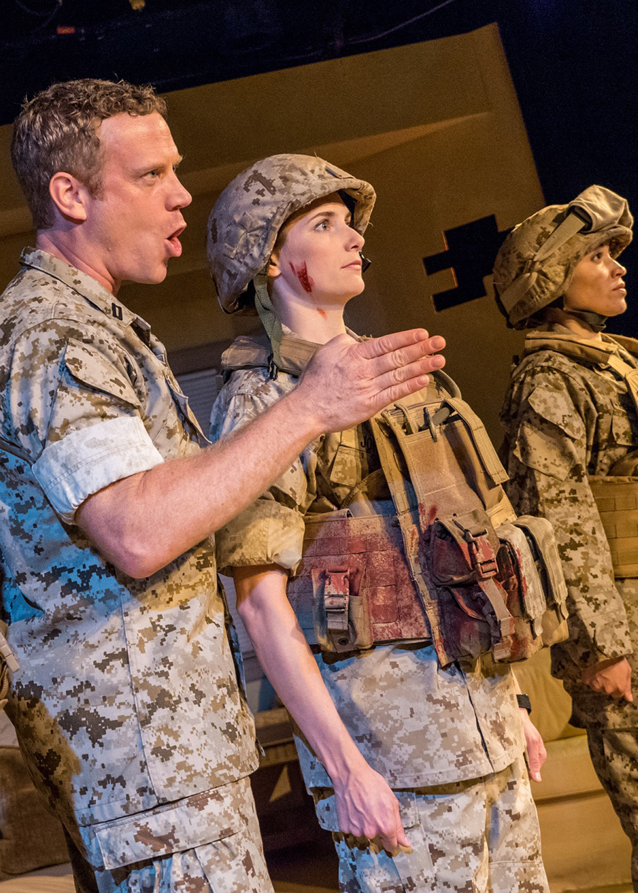 Production Photo from Soldier's Heart (2014). Two women and one man in one line stand at attention in Army uniforms. An Army uniformed man stands between them, giving orders.