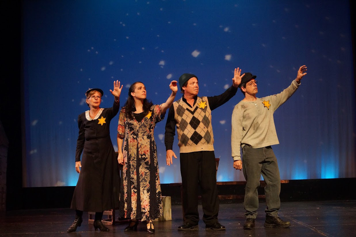 Under the night sky, four people reach toward the stars