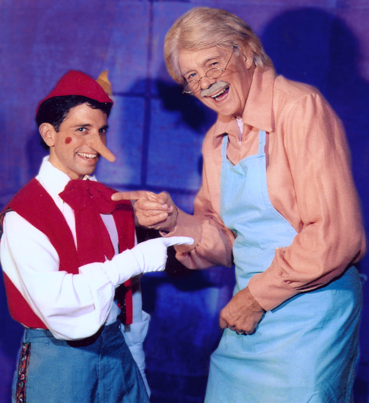Pinocchio and Geppetto laugh together