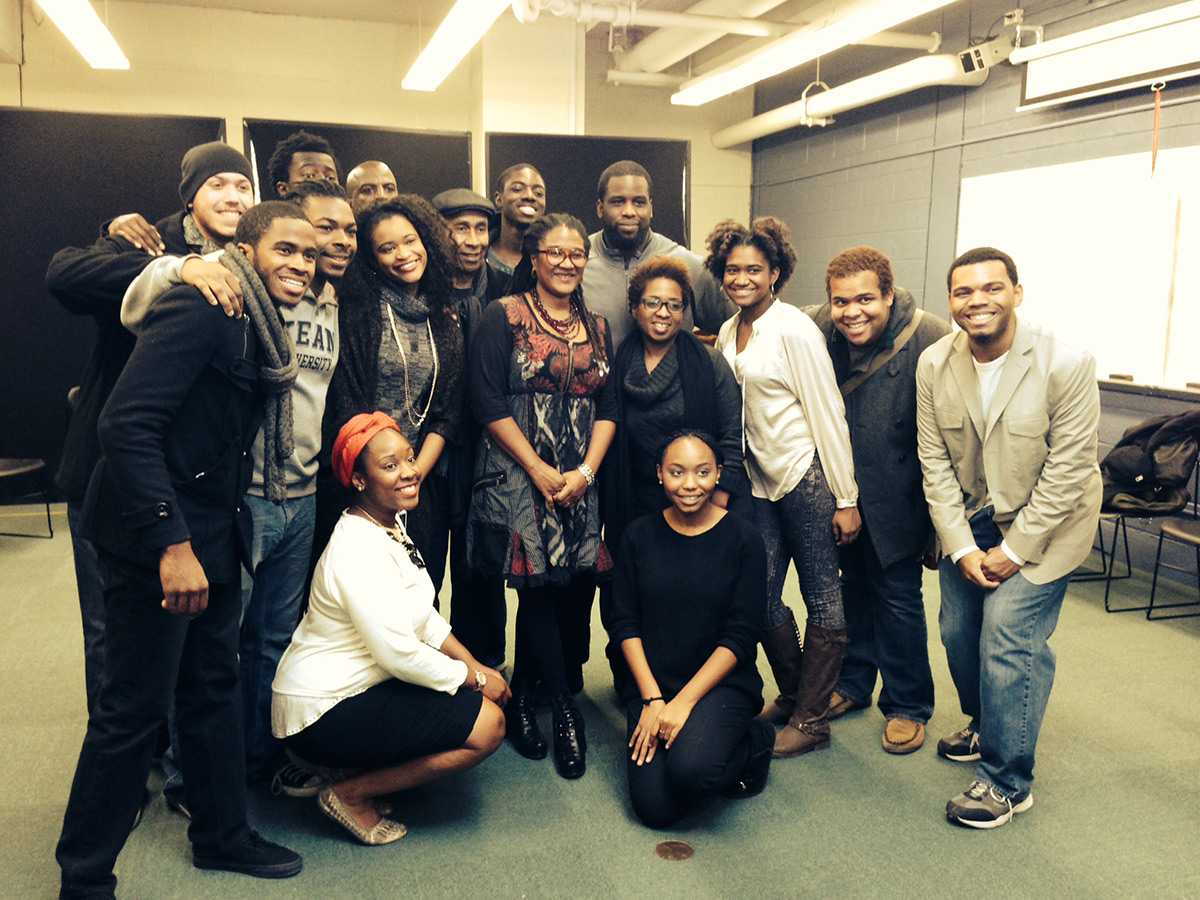 Playwright Lynn Nottage gathers with a group of students.